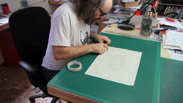 Heathrow Christmas card - Rob Ryan preparing to cut the paper