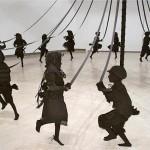 Paper Sculpture of Children Happily Dancing