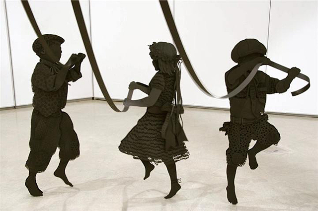 Paper Sculpture of Children Happily Dancing