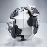 Globe Puzzle Piece Sculpture by The Makerie Stuido