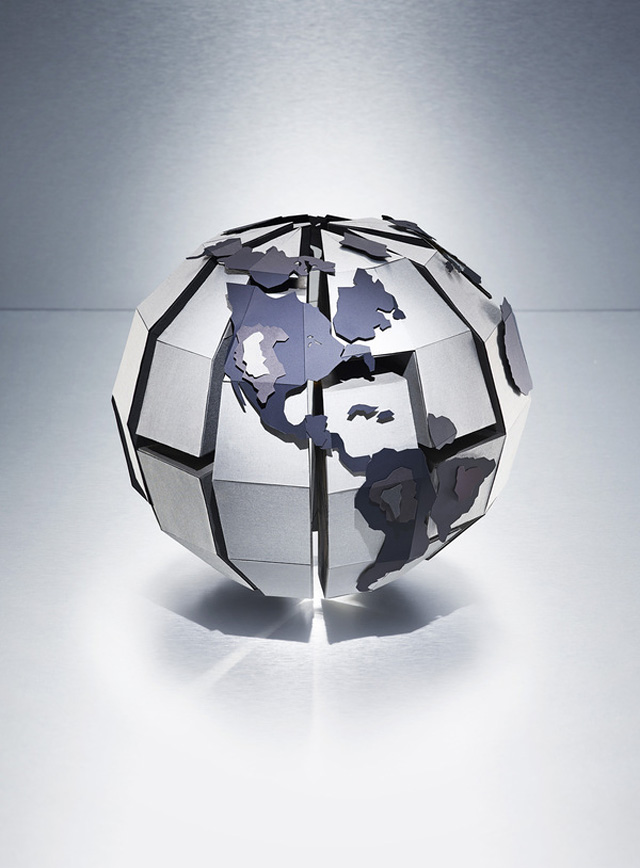 Globe Puzzle Piece Sculpture by The Makerie Studio