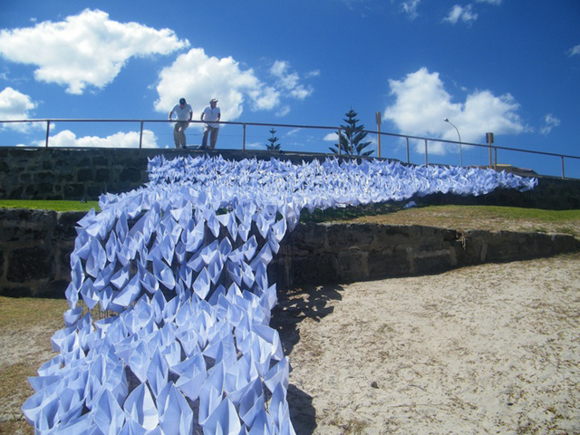 1,697 Origami Boats Flow Down to the Sea