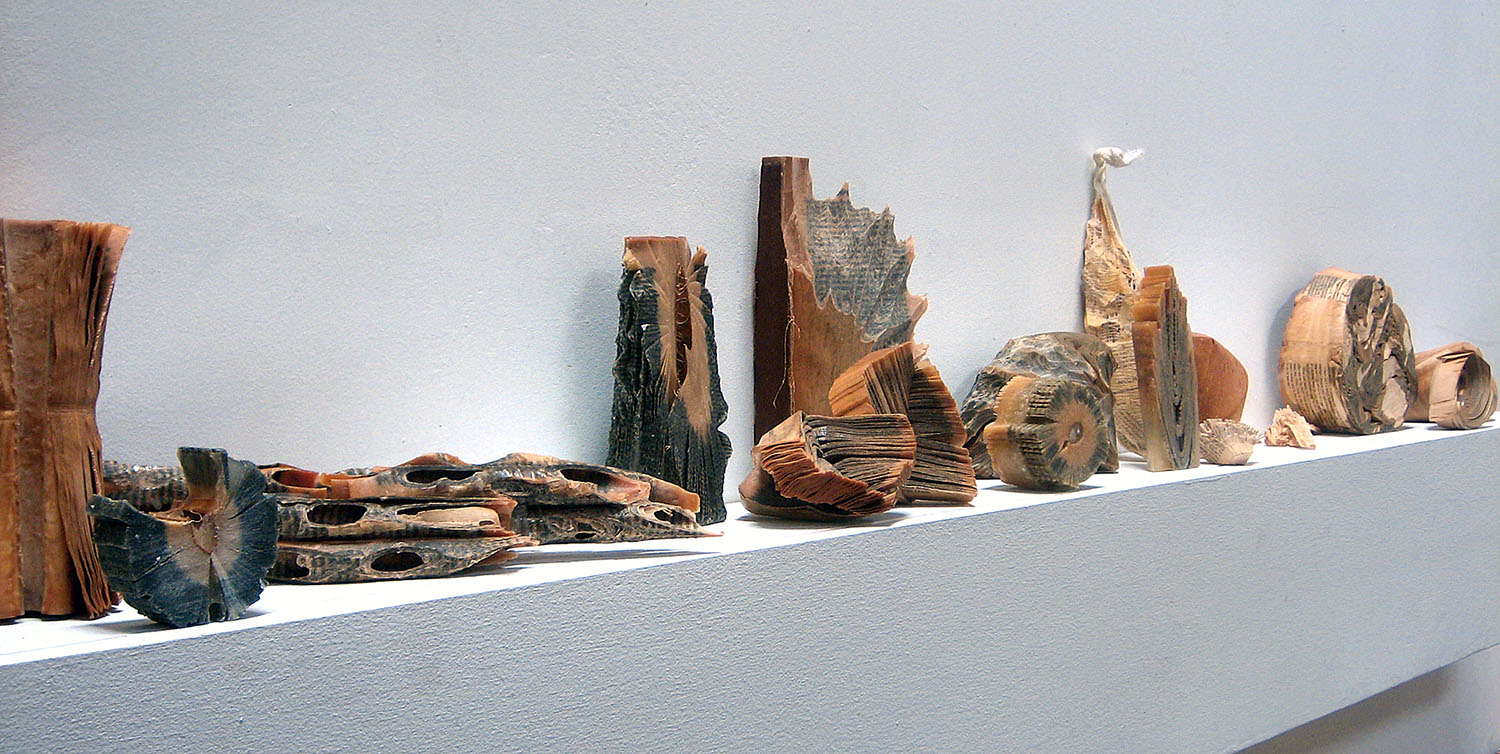 Artist Creates Massive Altered Book Sculptures Coated in Wax by Jessica Drenk - Reading Our Remains Shelf Carvings