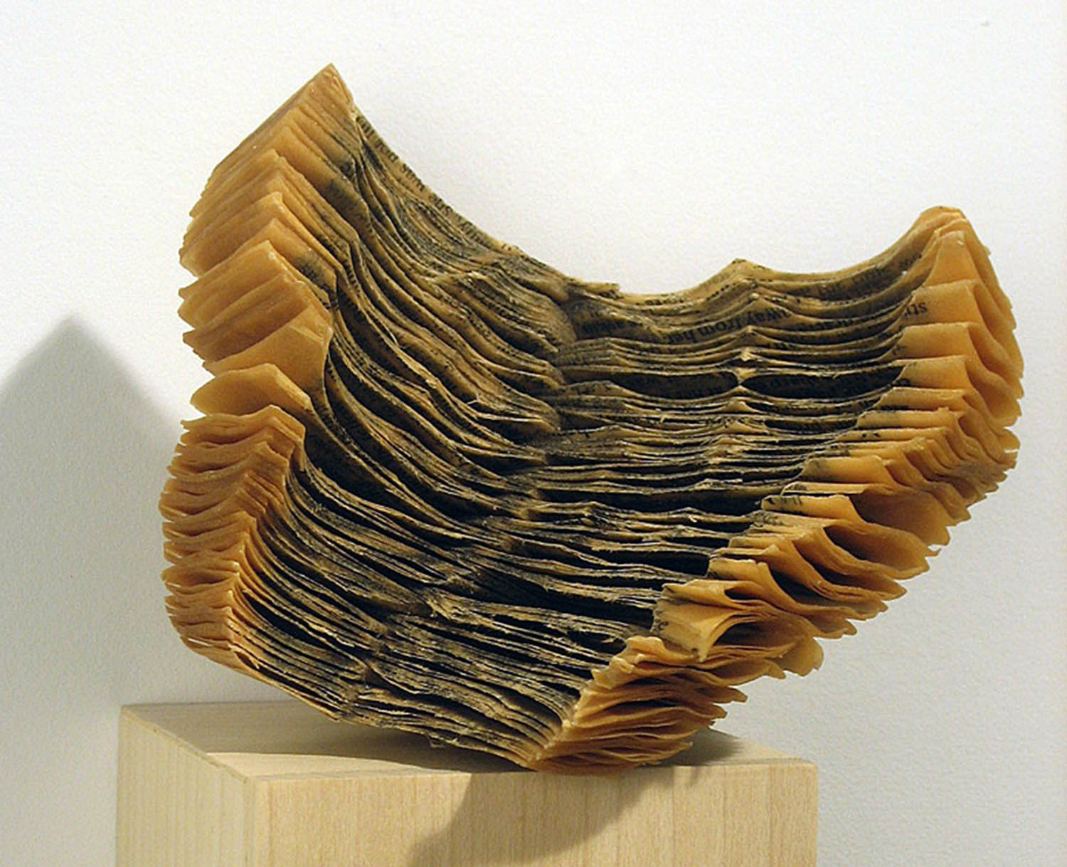 Artist Creates Massive Altered Book Sculptures Coated in Wax by Jessica Drenk - Reading Our Remains Carving Shuffle