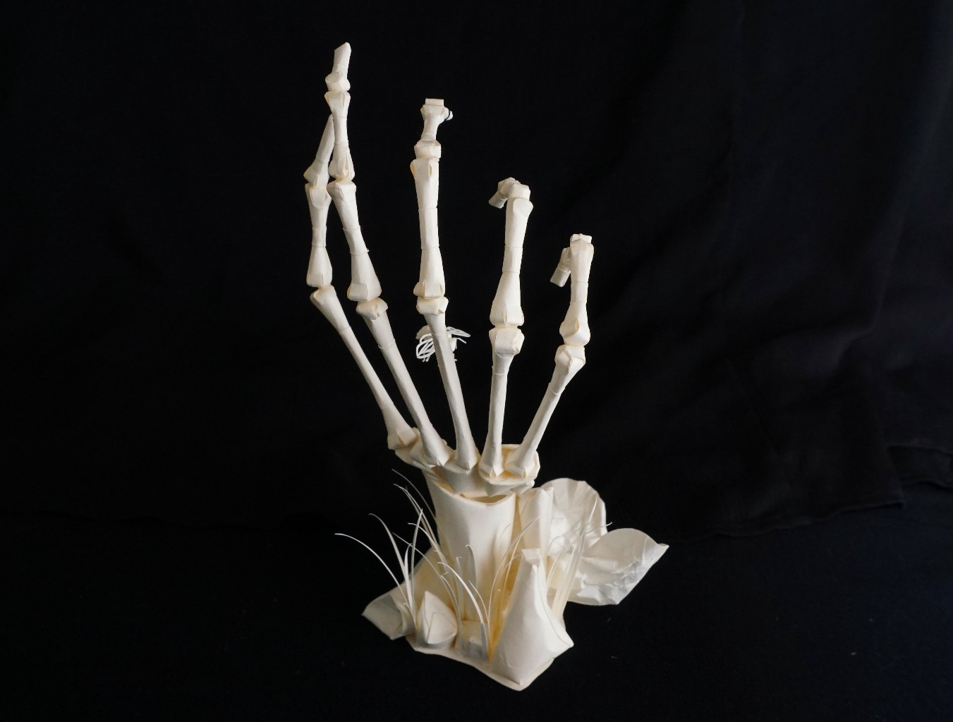 Eerily Beautiful and Macabre Paper Sculptures by Sinan Soykut - Skeleton Hand