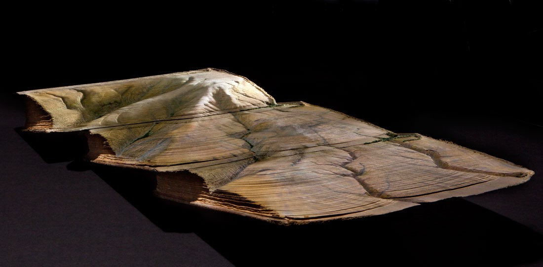 Guy Laramee Creates Hyperrealistic Topographic Landscapes Carved into Old Books - The Extant Works