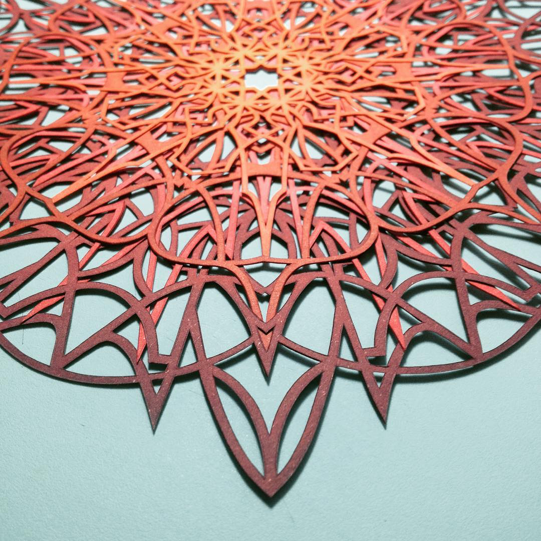 Intricate Interlocked Geometric Cut Paper Sculptures Inspired by Science and Nature